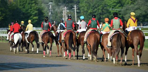 The post parade for the 99th running of the Coaching Club American Oaks heads out on to the main track at the Saratoga Race Course Sunday afternoon July 26, 2015 in Saratoga Springs, N.Y.    (Skip Dickstein/Times Union) Photo: SKIP DICKSTEIN