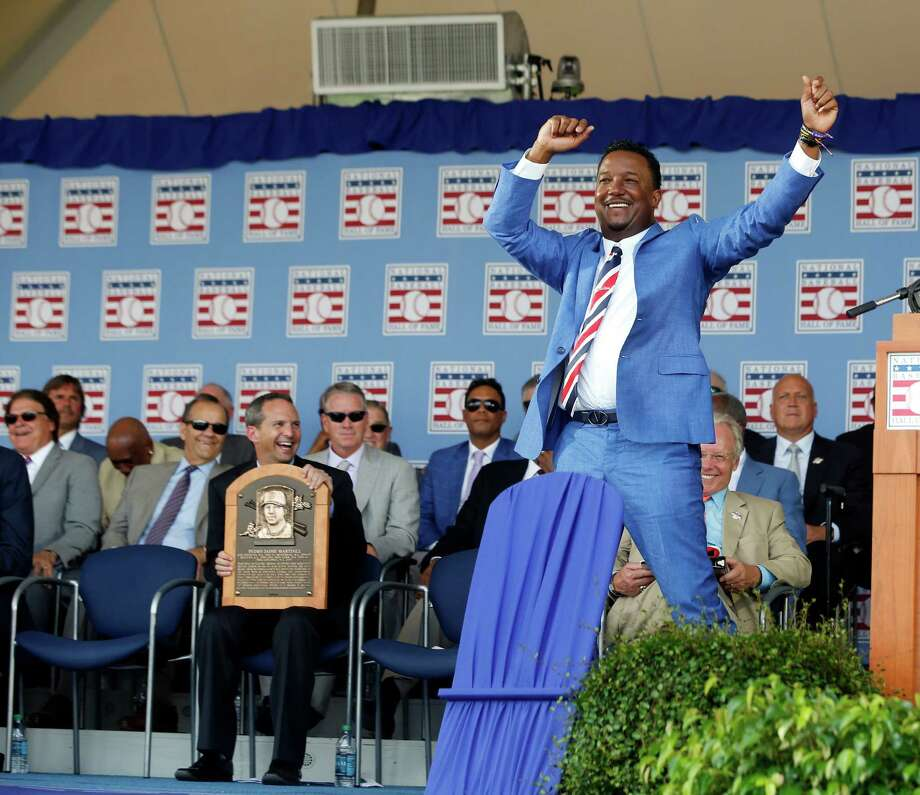 National Baseball Hall of Fame inductee Pedro Martinez dances during an induction ceremony at the Clark Sports Center, Sunday, July 26, 2015, in Cooperstown, N.Y. Martinez, Randy Johnson, John Smoltz and Craig Biggio were inducted into the Hall of Fame on Sunday. (AP Photo/Mike Groll) ORG XMIT: NYMG124 Photo: Mike Groll / AP