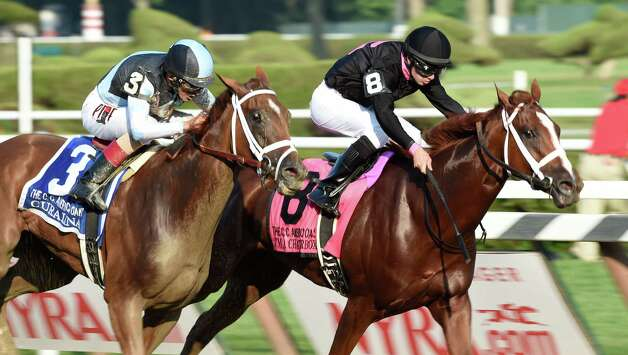 #3 Curalina ridden by jockey John Velazquez was placed first after #8 I'm a ChatterBox with Florent Geroux was disqualified in the 99th running of the Coaching Club American Oaks at the Saratoga Race Course Sunday afternoon July 26, 2015 in Saratoga Springs, N.Y.    (Skip Dickstein/Times Union) Photo: SKIP DICKSTEIN