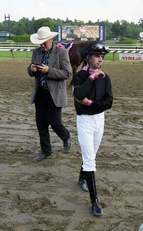 Jockey Florent Geroux shows the dejection after he was disqualified on I'm a Chatterbox in the 99th running of the Coaching Club American Oaks after he interfered with the ultimate winner Curalina at the Saratoga Race Course Sunday afternoon July 26, 2015 in Saratoga Springs, N.Y.  In the background is I'm a Chatterbox's trainer Larry Jones.  (Skip Dickstein/Times Union) Photo: SKIP DICKSTEIN