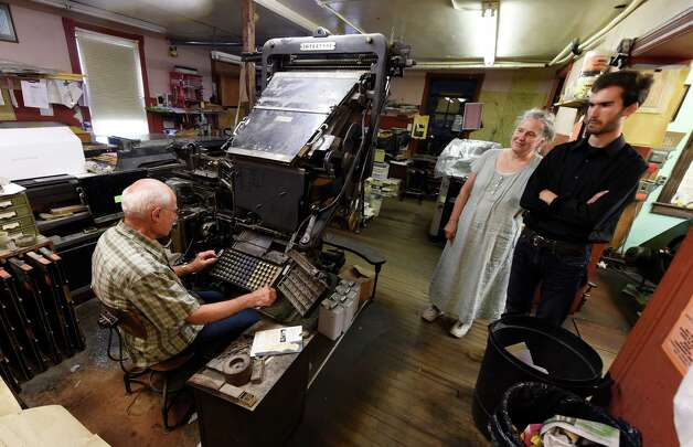 James Gardner Sr. set type the old fashioned way as Co publishers Melissa Hale-Spencer, center and Marcello Iaia watch Monday morning, July 20, 2015, in Altamont, N.Y.    (Skip Dickstein/Times Union) Photo: SKIP DICKSTEIN / 00032608A