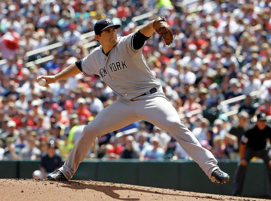 New York Yankees starting pitcher Nathan Eovaldi delivers to the Minnesota Twins during the first inning of a baseball game in Minneapolis, Sunday, July 26, 2015.  (AP Photo/Ann Heisenfelt) ORG XMIT: MNAH101 Photo: Ann Heisenfelt / FR13069 AP