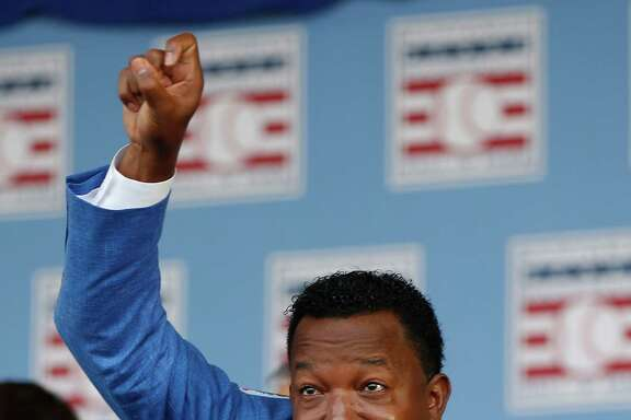 Pedro Martinez hams it up on stage during the Hall of Fame induction ceremony on the grounds at Clark Sports Center on Sunday, July 26, 2015, in Cooperstown. ( Karen Warren / Houston Chronicle )