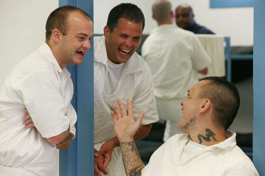 Veterans  Charles Shipp (from left), Eric Jimenez and Cody Beggs joke around as they wait for lunch in a veteran's dorm at the Travis State Jail in Austin. Photo: JERRY LARA, Staff / © 2015 San Antonio Express-News