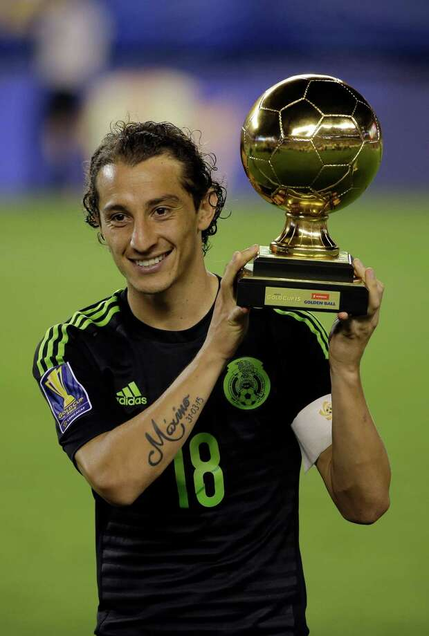 Mexico's Andres Guardado poses with the Golden Ball trophy after the CONCACAF Gold Cup championship soccer match against Jamaica, Sunday, July 26, 2015, in Philadelphia. Mexico won 3-1. (AP Photo/Matt Rourke) ORG XMIT: PXE133 Photo: Matt Rourke / AP