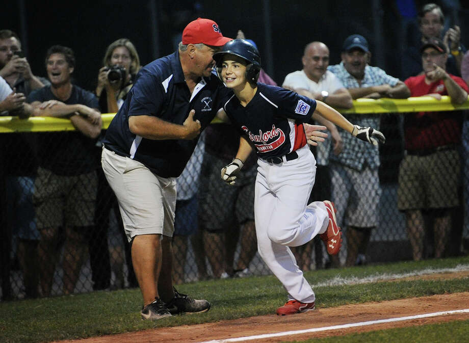 Stamford North's Todd Guttman smiles toward his teammates waiting to welcome him at home plate after clocking a game-tying fifth-inning home run in the Little League Division 1 championship Sunday in Stamford. Photo: Brian A. Pounds / Hearst Connecticut Media / Connecticut Post