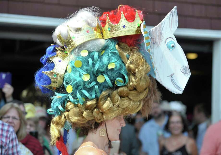 Julie Potter from Duanesburg, wearing her triple crown hat she created, won first place in the Uniquely Saratoga category during the 24th annual Hat Contest, presented by Hat Sational by DEI at the Saratoga Race Course on Sunday, July 26, 2015, in Saratoga Springs, N.Y.  The first place win gave Potter her own triple crown, she won the contest in 2012 and 2014.  (Paul Buckowski / Times Union) Photo: PAUL BUCKOWSKI / 00032762A