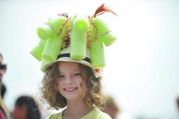 Oliva Grove, 9, from Dunwoody, GA, won first place in the Kreative Kids category during the 24th annual Hat Contest, presented by Hat Sational by DEI at the Saratoga Race Course on Sunday, July 26, 2015, in Saratoga Springs, N.Y.  (Paul Buckowski / Times Union) Photo: PAUL BUCKOWSKI / 00032762A