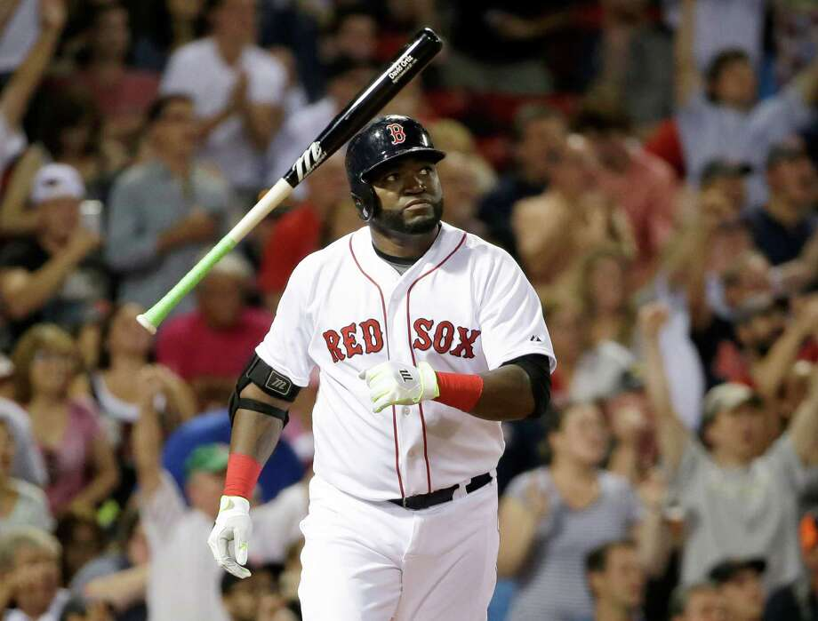 Boston Red Sox's David Ortiz tosses the bat as he watches the flight of his three-run home run in the fifth inning of a baseball game against the Detroit Tigers at Fenway Park, Sunday, July 26, 2015, in Boston. (AP Photo/Steven Senne) ORG XMIT: MASR107 Photo: Steven Senne / AP