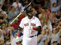 Boston Red Sox's David Ortiz tosses the bat as he watches the flight of his three-run home run in the fifth inning of a baseball game against the Detroit Tigers at Fenway Park, Sunday, July 26, 2015, in Boston. (AP Photo/Steven Senne) ORG XMIT: MASR107