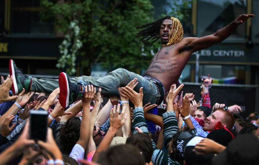 Meechy Darko of Flatbush Zombies is carried by the crowd during day three of Capitol Hill Block Party. The three day festival brings music and tens of thousands of fans to the center of Seattle's Capitol Hill neighborhood. Photographed on Sunday, July 26, 2015.