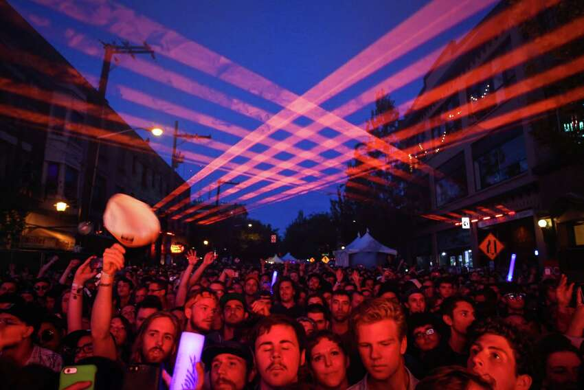 Lasers light up the sky as Ratatat takes the stage during day three of Capitol Hill Block Party. The three day festival brings music and tens of thousands of fans to the center of Seattle's Capitol Hill neighborhood. Photographed on Sunday, July 26, 2015.