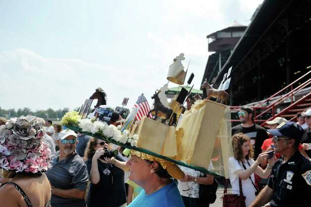 Ann Medici from Latham won second place in the Uniquely Saratoga category during the 24th annual Hat Contest, presented by Hat Sational by DEI at the Saratoga Race Course on Sunday, July 26, 2015, in Saratoga Springs, N.Y.  (Paul Buckowski / Times Union) Photo: PAUL BUCKOWSKI / 00032762A