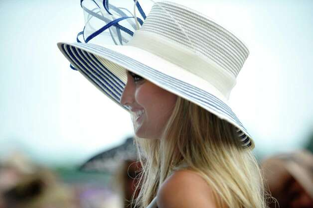 Jessielyn Palumbo from Wayne, NJ, takes part in the Fashionably Saratoga category during the 24th annual Hat Contest, presented by Hat Sational by DEI at the Saratoga Race Course on Sunday, July 26, 2015, in Saratoga Springs, N.Y.  (Paul Buckowski / Times Union) Photo: PAUL BUCKOWSKI / 00032762A