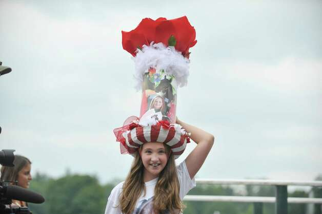 Samantha Tracy, 9, from Greenfield takes part in the Kreative Kids category during the 24th annual Hat Contest, presented by Hat Sational by DEI at the Saratoga Race Course on Sunday, July 26, 2015, in Saratoga Springs, N.Y.  (Paul Buckowski / Times Union) Photo: PAUL BUCKOWSKI / 00032762A