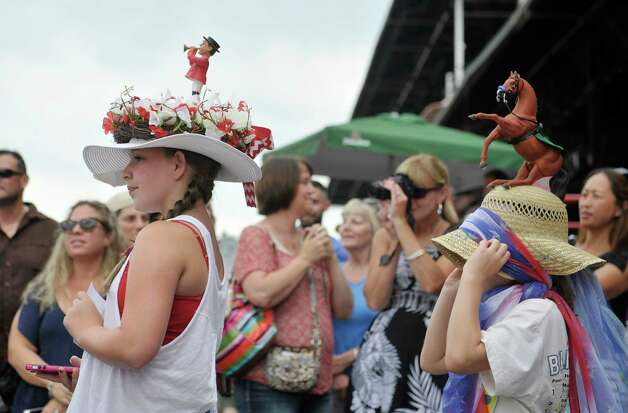 Michaela Reardon, left, 12, from Ballston Lake and Caroline Merolle, 7, from Latham take part in the Kreative Kids category during the 24th annual Hat Contest, presented by Hat Sational by DEI at the Saratoga Race Course on Sunday, July 26, 2015, in Saratoga Springs, N.Y.  Reardon won third place.  (Paul Buckowski / Times Union) Photo: PAUL BUCKOWSKI / 00032762A