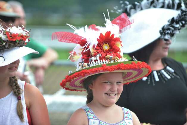 Madison Turman, 10, from Burlington, VT, won second place in the Kreative Kids category during the 24th annual Hat Contest, presented by Hat Sational by DEI at the Saratoga Race Course on Sunday, July 26, 2015, in Saratoga Springs, N.Y.  (Paul Buckowski / Times Union) Photo: PAUL BUCKOWSKI / 00032762A