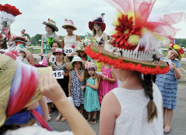 Contestants in the Kreative Kids category take part in the 24th annual Hat Contest, presented by Hat Sational by DEI at the Saratoga Race Course on Sunday, July 26, 2015, in Saratoga Springs, N.Y.  (Paul Buckowski / Times Union) Photo: PAUL BUCKOWSKI / 00032762A