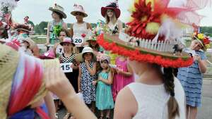 Contestants in the Kreative Kids category take part in the 24th annual Hat Contest, presented by Hat Sational by DEI at the Saratoga Race Course on Sunday, July 26, 2015, in Saratoga Springs, N.Y.  (Paul Buckowski / Times Union)