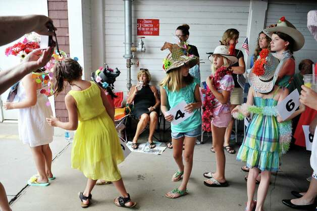 Contestants in the Kreative Kids category line up before the start of the 24th annual Hat Contest, presented by Hat Sational by DEI at the Saratoga Race Course on Sunday, July 26, 2015, in Saratoga Springs, N.Y.  (Paul Buckowski / Times Union) Photo: PAUL BUCKOWSKI / 00032762A