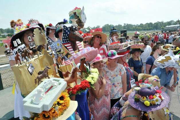 Contestants in the Uniquely Saratoga category gather for a photo during the 24th annual Hat Contest, presented by Hat Sational by DEI at the Saratoga Race Course on Sunday, July 26, 2015, in Saratoga Springs, N.Y.  (Paul Buckowski / Times Union) Photo: PAUL BUCKOWSKI / 00032762A