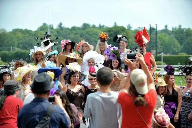 Contestants in the Fashionably Saratoga category gather for a group photo during the 24th annual Hat Contest, presented by Hat Sational by DEI at the Saratoga Race Course on Sunday, July 26, 2015, in Saratoga Springs, N.Y.  (Paul Buckowski / Times Union) Photo: PAUL BUCKOWSKI / 00032762A