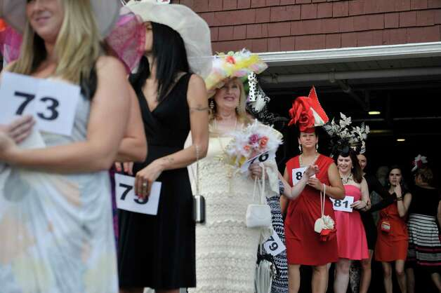 Contestants in the Fashionably Saratoga category walk out to be judged during the 24th annual Hat Contest, presented by Hat Sational by DEI at the Saratoga Race Course on Sunday, July 26, 2015, in Saratoga Springs, N.Y.  (Paul Buckowski / Times Union) Photo: PAUL BUCKOWSKI / 00032762A