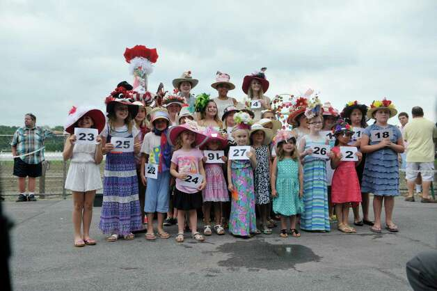 Contestants in the Kreative Kids category pose for a group photo during the 24th annual Hat Contest, presented by Hat Sational by DEI at the Saratoga Race Course on Sunday, July 26, 2015, in Saratoga Springs, N.Y.  (Paul Buckowski / Times Union) Photo: PAUL BUCKOWSKI / 00032762A