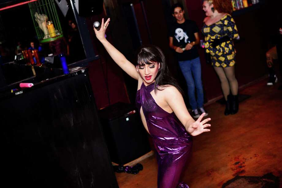 Selena QuintanillaWhat you need: Either a bustier and high waisted black pants or a purple pantsuit, red lipstick, straight black hair, a microphone or a slice of pizza. Photo: Kody Melton/ MySA