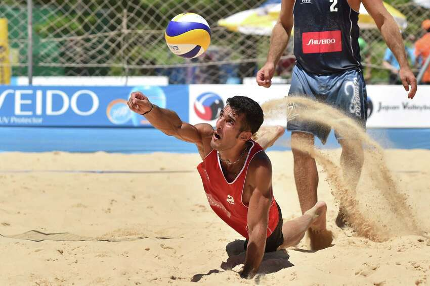 Abbas Pourasgari of Iran receives the ball in the qualification match against Jean-Baptiste Daguerre and Yannick Salvetti of France during FIVB Yokohama Grand Slam - Day 1 on July 21, 2015 in Yokohama, Japan.