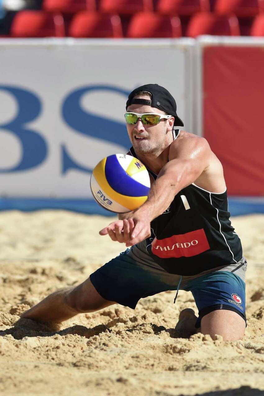 Grant O'Gorman of Canada receives the ball in the qualification match against Nicholas Lucena and Theodore Brunner of the USA during FIVB Yokohama Grand Slam - Day 1 on July 21, 2015 in Yokohama, Japan.