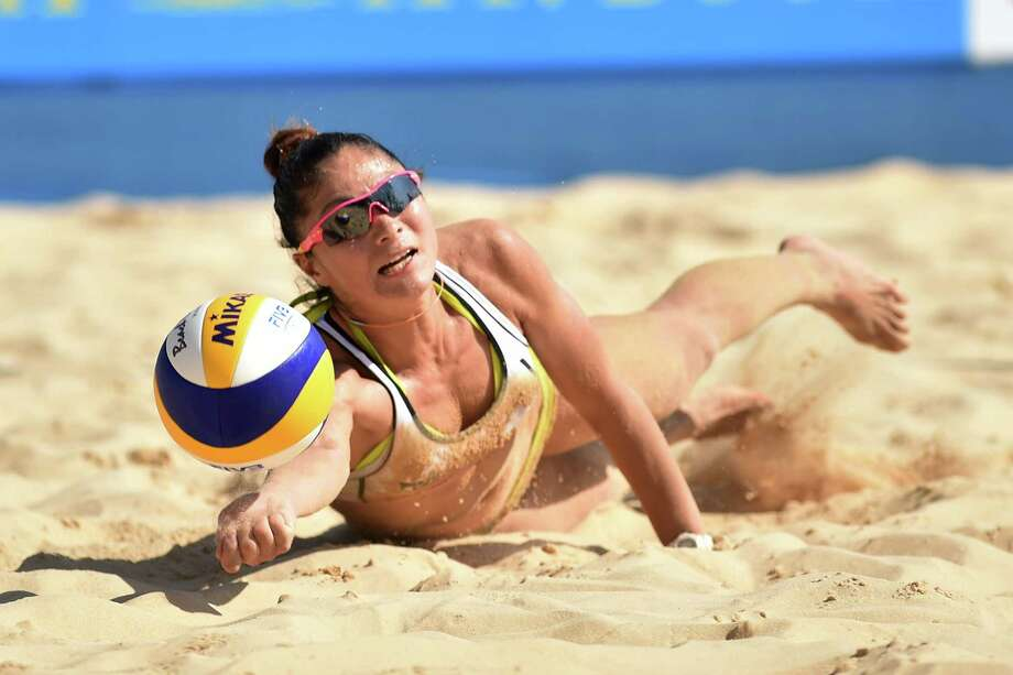 Erika Habaguchi of Japan receives the ball in the qualification match against Miyuki Matsumura and Hiroko Matsuyama of Japan during FIVB Yokohama Grand Slam - Day 1 on July 21, 2015 in Yokohama, Japan. Photo: Atsushi Tomura, Getty Images  / 2015 Getty Images