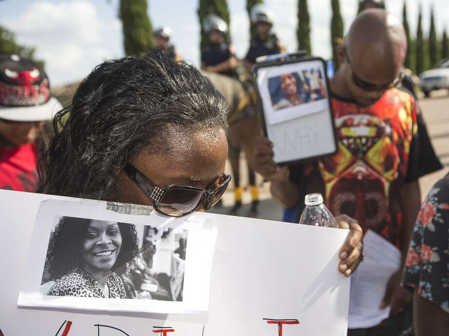 Margaret Hilaire bows her head in prayer during a demonstration calling for the firing and indictment of Texas State Trooper Brian Encinia, Sunday, July 26, 2015, in Katy, Texas. Sandra Bland was found dead in her cell on July 13 in the Waller County Jail, just days after being arrested by Encinia during a traffic stop. Authorities determined through an autopsy that Bland hanged herself with a plastic bag. (Brett Coomer/Houston Chronicle via AP) Photo: Brett Coomer, Associated Press
