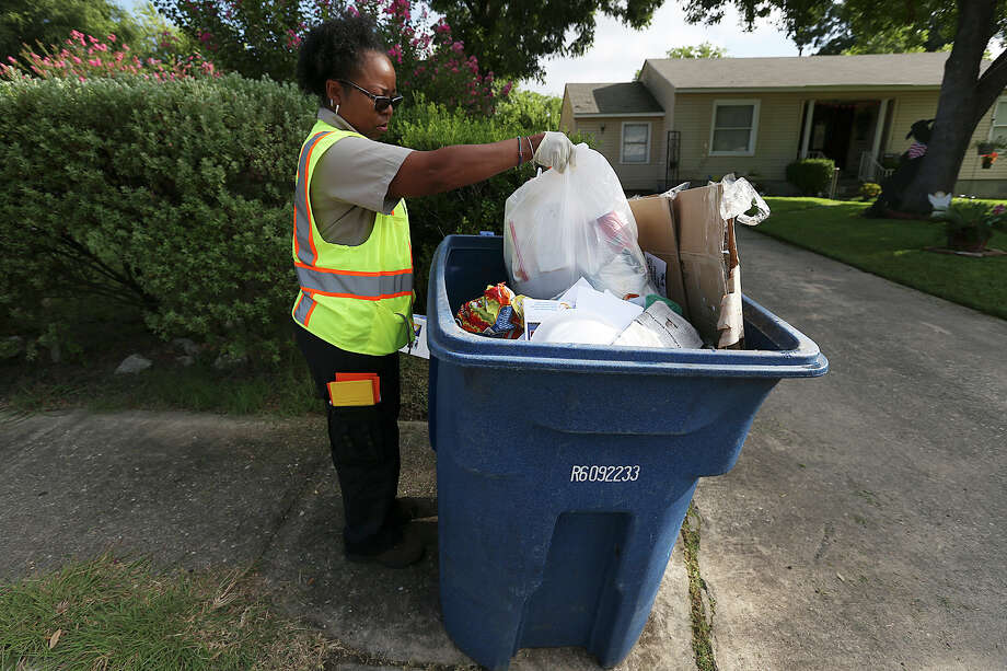 San Antonio Solid Waste Department route inspector Asia Jones-Carr finds household trash in a recycling can along her route on West Mandalay Drive and West Thorain Boulevard near Blanco Road, Monday, July 20, 2015. Household garbage and air conditioning filters are among items not allowed in the can and in this case, the homeowner was allowed to remove the items. In other cases, services can be refused. Photo: JERRY LARA, Staff / San Antonio Express-News / © 2015 San Antonio Express-News