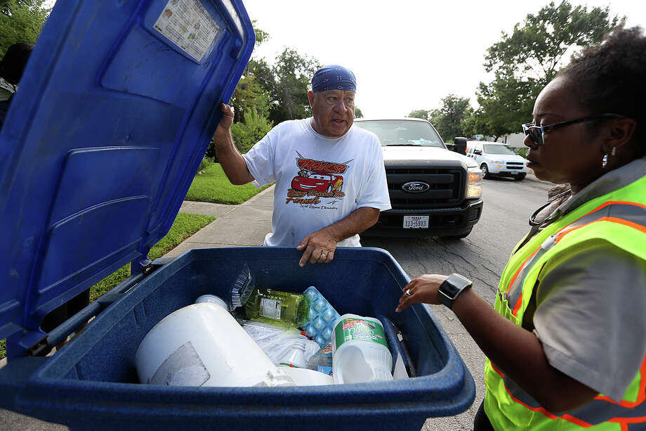 San Antonio Solid Waste Department route inspector Asia Jones-Carr talks with a homeowner as she inspects recycling cans for unauthorized items such as household garbage and air conditioning filters. No such items were found in this recycling can, but a reader laments the fact that many recycling cans do contain trash. Photo: JERRY LARA /San Antonio Express-News / © 2015 San Antonio Express-News