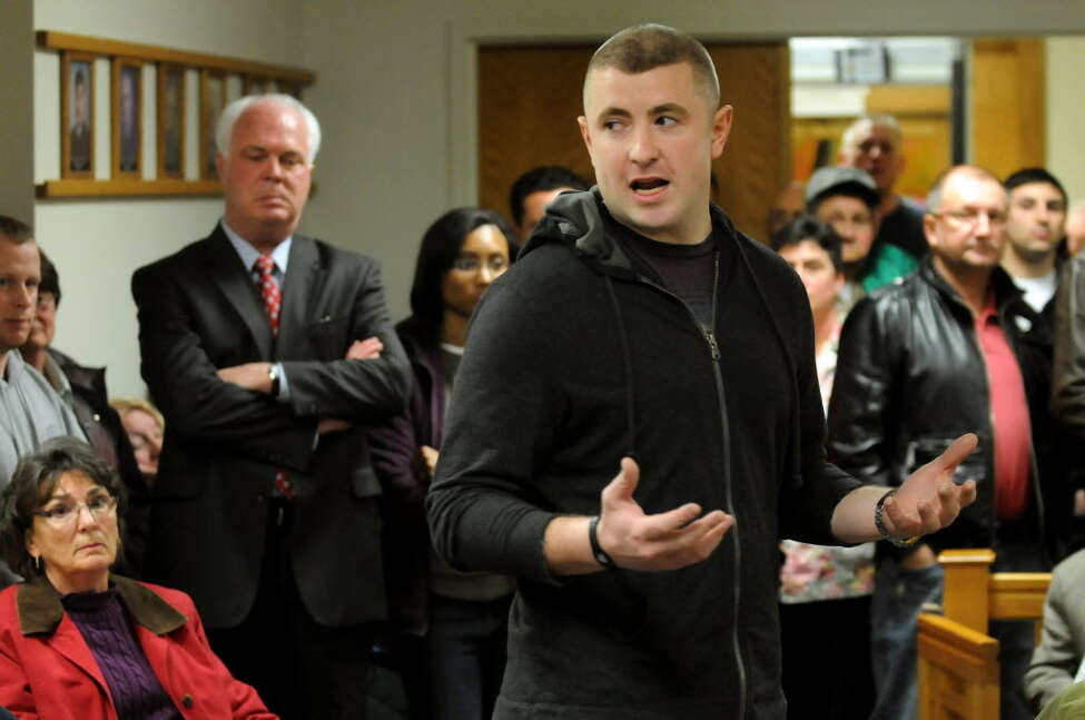 In this photograph, Joshua Spratt, the Watervliet police officer arraigned July 27, 2015, on sex charges, comments on the redevelopment plan for the St. Patrick's Church property on Thursday, March 15, 2012, at City Hall in Watervliet, N.Y. (Cindy Schultz / Times Union archive)