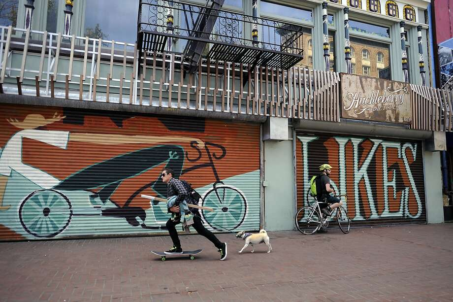 Above: Murals cover the roll-up doors of the Huckleberry Bicycle shop on Market Street. Photo: Michael Short, Special To The Chronicle