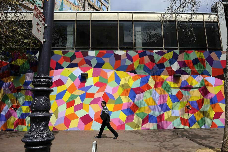 Kristin Farr's mural is actually a vinyl print of one of her paintings applied to a temporary construction wall on Market Street near Seventh Streets. Photo: Michael Short, Special To The Chronicle