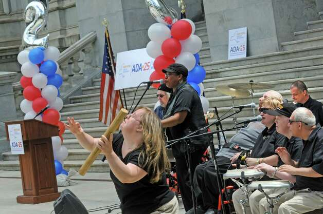The band Flame, a group of talented musicians who happen to have disabilities, perform during a celebration of the 25th Anniversary of the signing of the landmark Americans with Disabilities Act (ADA) at the West Park of the Capitol on Friday July 24, 2015 in Albany, N.Y. (Michael P. Farrell/Times Union) Photo: Michael P. Farrell / 00032753A