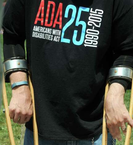 Shawn Fultz of Albany wears an event t-shirt during a celebration of the 25th Anniversary of the signing of the landmark Americans with Disabilities Act (ADA) at the West Park of the Capitol on Friday July 24, 2015 in Albany, N.Y. (Michael P. Farrell/Times Union) Photo: Michael P. Farrell / 00032753A