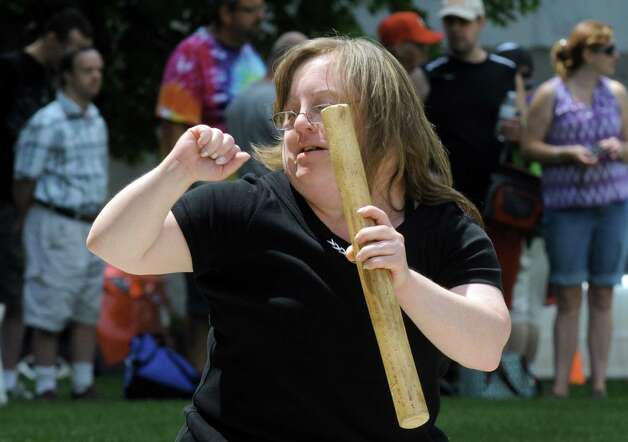Debbie Woodruff a dancer with the band Flame, a group of talented musicians who happen to have disabilities, foolws the groove as they perform during a celebration of the 25th Anniversary of the signing of the landmark Americans with Disabilities Act (ADA) at the West Park of the Capitol on Friday July 24, 2015 in Albany, N.Y. (Michael P. Farrell/Times Union) Photo: Michael P. Farrell / 00032753A