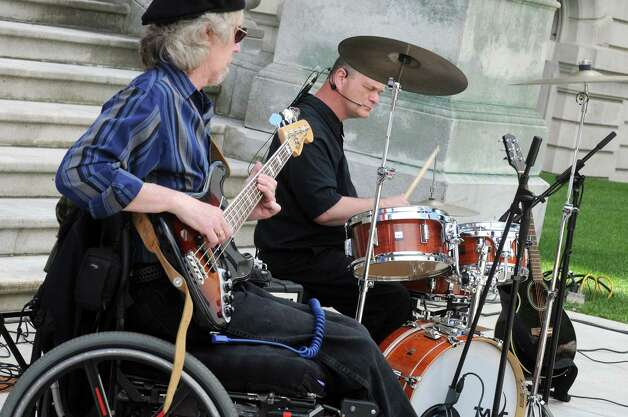 Nick Robinson, left, on bass and David LaGrange on drums for the band Flame, a group of talented musicians who happen to have disabilities, as they perform during a celebration of the 25th Anniversary of the signing of the landmark Americans with Disabilities Act (ADA) at the West Park of the Capitol on Friday July 24, 2015 in Albany, N.Y. (Michael P. Farrell/Times Union) Photo: Michael P. Farrell / 00032753A