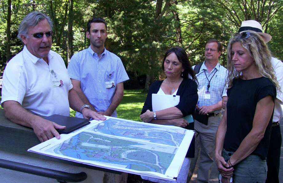 Wesley Stout of Wesley Stout Associates, left, goes over proposed plans for the Bridgewater Associates site prior to a tour of the corporate campus by members of the Conservation Commission. Photo: Anne M. Amato / Hearst Connecticut Media / Westport News