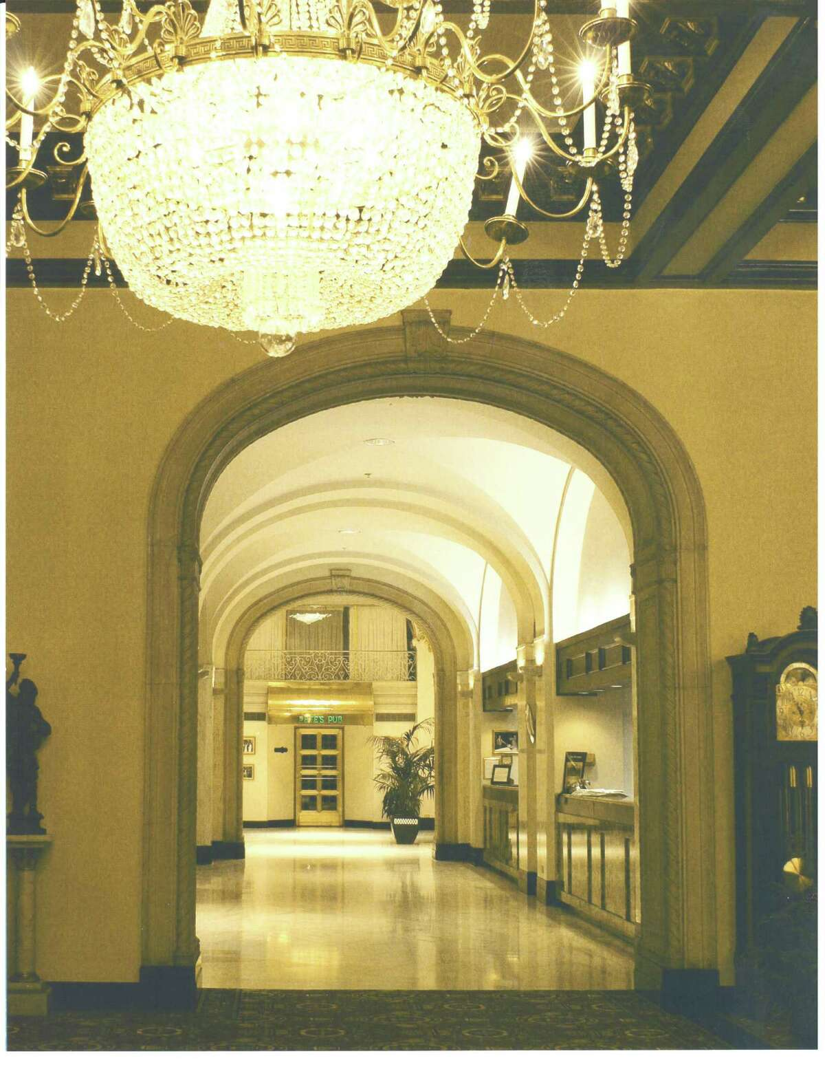 The hotel's opulent lobby and front desk.