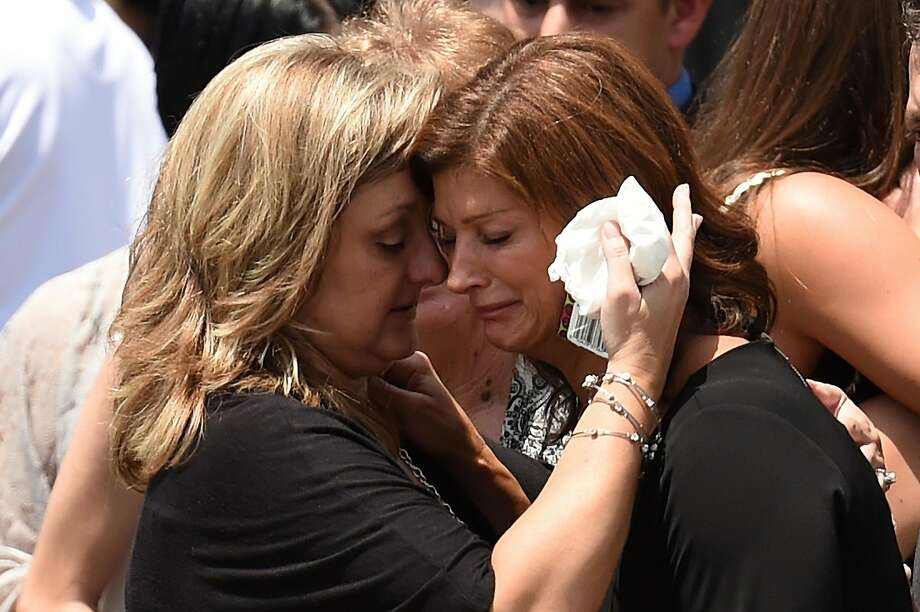 FRANKLIN, LA - JULY 27:  Dondie Breaux (R), mother of Maycie Breaux, is consoled outside of the Church of the Assumption on July 27, 2015 in Franklin, Louisiana.  Two people were killed and nine wounded when a shooter identified as John Russell Houser, 59, opened fire in a theater before killing himself, according to police.  (Photo by Stacy Revere/Getty Images) Photo: Stacy Revere, Getty Images