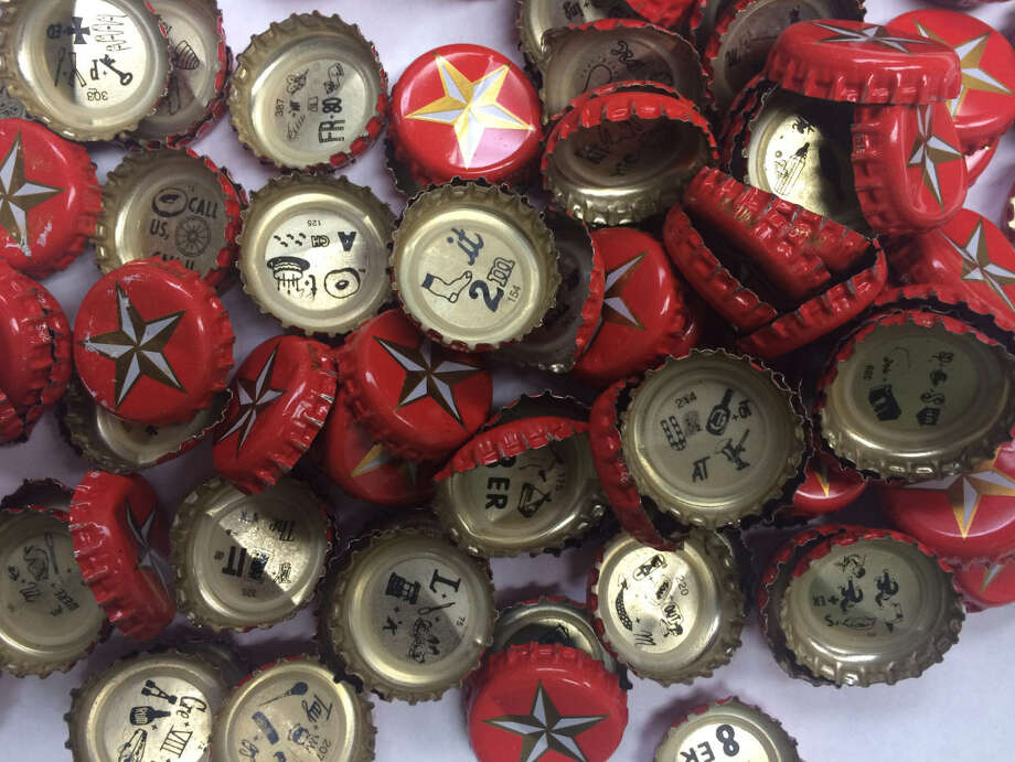 QUIZ: Lone Star Beer bottlecap puzzlesLone Star Beer has been putting rebus puzzles on the inside of its bottle caps since 2001 (Lone Star Light came on board in 2005). See if you can solve some of these highly popular puzzles ...  Photo: John Boyd, Houston Chronicle