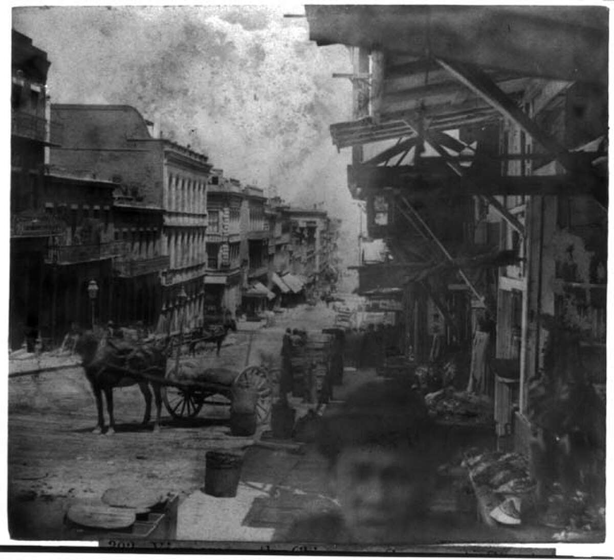 Chinatown, as seen from Sacramento St. This image is particularly haunting thanks to the young man in the foreground.