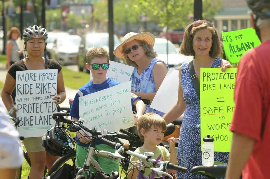 Protesters listen to speakers at a rally for protected bike lanes on Madison Avenue on Monday, July 27, 2015, in Albany, N.Y. (Olivia Nadel/ Special to the Times Union) Photo: ON / 00032739A