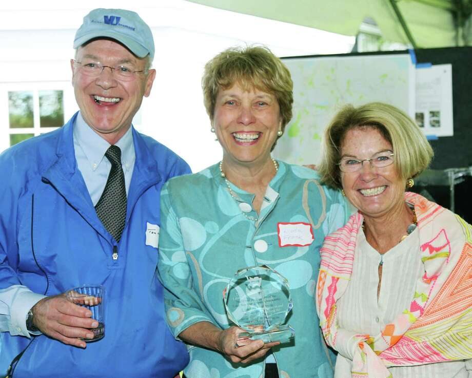 Executive director Tom McGowan of the Lake Waramaug Task Force joins retiring chairwoman Linda M. Frank, center, and Molly Butler Hart, incoming chairwoman, as they celebrate the task forceâÄôs 40th anniversary.  Courtesy of Lucy Mullen Ball. Photo: Contributed Photo / Contributed Photo / The News-Times Contributed