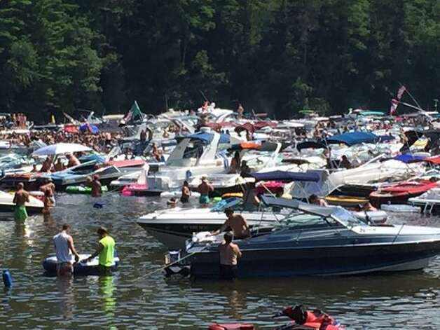 Boaters and swimmers party during Log Bay Day on Lake George on July 27, 2015. (Lori Van Buren/Times Union)